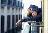Woman Suffering Depression And Stress Outdoors At The Balcony