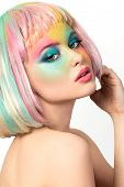 picture of hair dye  - Portrait of young woman with funny rainbow coloured make - JPG