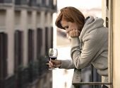 Attractive Woman Suffering Depression And Stress Outdoors At The Balcony