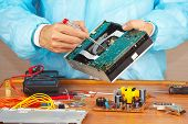 Master servicing electronic devices in service workshop
