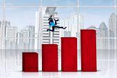 Businesswoman Jumps Over Business Chart