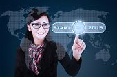 Businesswoman With A Start Button To Future