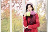 Girl Blowing Warm Drink