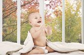 Happy Baby On Bedroom Laughing Alone