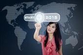 Hispanic Businesswoman With Future Button