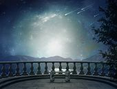 Balcony and landscape. Elements of this image furnished by NASA