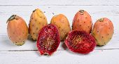 Prickly Pears On A White Wooden Table