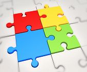 Focus On Four Colored Puzzle Pieces