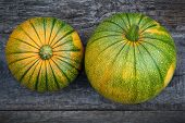 Fresh pumpkin on wooden table