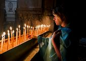 The Pilgrims Lit Candles At The Church Of The Holy Sepulchre In Jerusalem