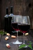 Glass Of Red Wine On Old Wooden Table