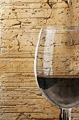 Wine glass on a terracotta background