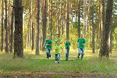 Happy cheerful family running