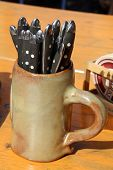 Beer mug with cutlery