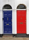Red And Blue Doors With White Surrounds