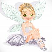 Beautiful fairy girl in white dress sit on floor