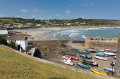 Coverack Cornwall with boats in the harbour in the late summer sunshine