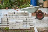 picture of paving  - Small pile of paving stones on a construction site - JPG