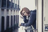 Young Woman Suffering Depression And Stress Outdoors At The Balcony