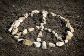 peace and love sign made with stones