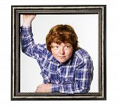 Red-haired Boy With Picture Frame