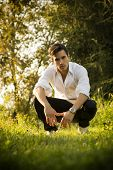 Handsome Sexy Man Outdoors In The Garden