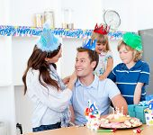 Elated Man Celebrating His Birthday With His Wife And His Children