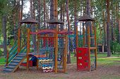 Bright Children's Playground In The Woods