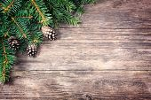 stock photo of fir  - Christmas fir tree on a wooden background - JPG