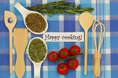 Happy cooking with selection of ingredients on checkered tablecloth