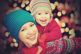 picture of winter trees  - happy family mother and baby little daughter playing in the winter for the Christmas holidays - JPG