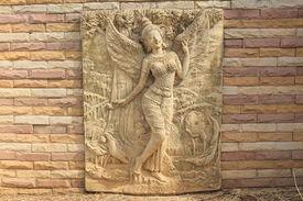 image of mahabharata  - close up for Kinnara statue on the wall - JPG