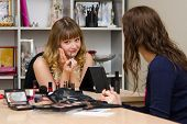 Office Staff In Consultation With Lipstick Make-up Artist