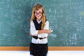 Clever nerd pupil blond girl in green board student schoolgirl