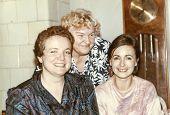 Vintage photo of elderly woman with her daughters in law, eighties