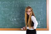 stock photo of clever  - Clever nerd pupil blond girl in green chalk board student schoolgirl - JPG