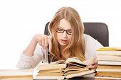 Pensive teenage woman learning to exam