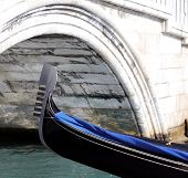 Venice, Bow Of Gondola Under The Bridge In The Waterway