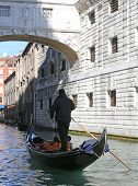 pic of gondolier  - Gondolier on channel of the bridge of sighs in Venice in Italy - JPG
