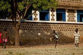 TORIT, SOUTH SUDAN-FEBRUARY 20, 2013: An unidentified group of kids play football in a village in South Sudan
