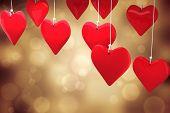 Love hearts against orange abstract light spot design