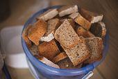 Cut Bread In  Bucket For Homeless People