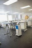 Empty class room with ironing board in college