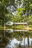 Villa In Swamp Area Gives A Harmonic Mirroring Picture In The Water Of A Flood