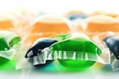 Gel capsules with laundry detergent close up