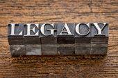 legacy  word in mixed vintage metal type printing blocks over grunge wood