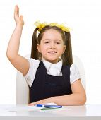 Schoolgirl at her desk isolated