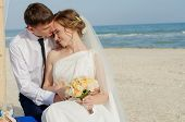 Young bride and groom on the beach