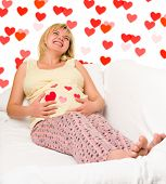 happy pregnant woman with hearts shape