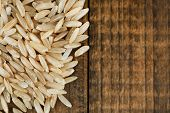 Rice grains on wooden background